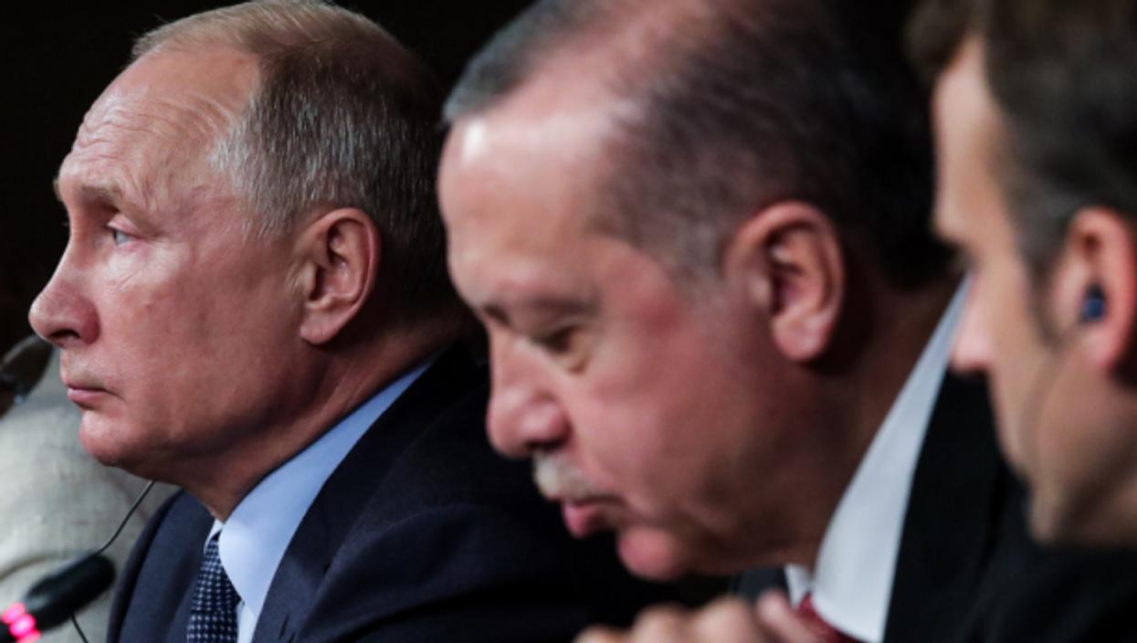 Putin, Erdogan and Macron in Istanbul in 2018