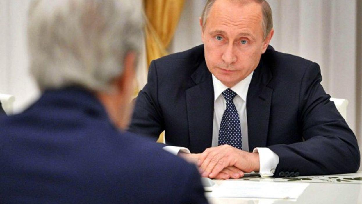 Putin facing U.S. Secretary of State John Kerry.