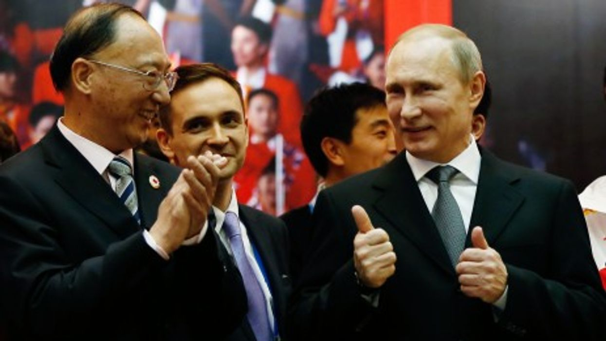 Putin with Liu Peng (front L), president of the Chinese Olympic Committee in Sochi in February