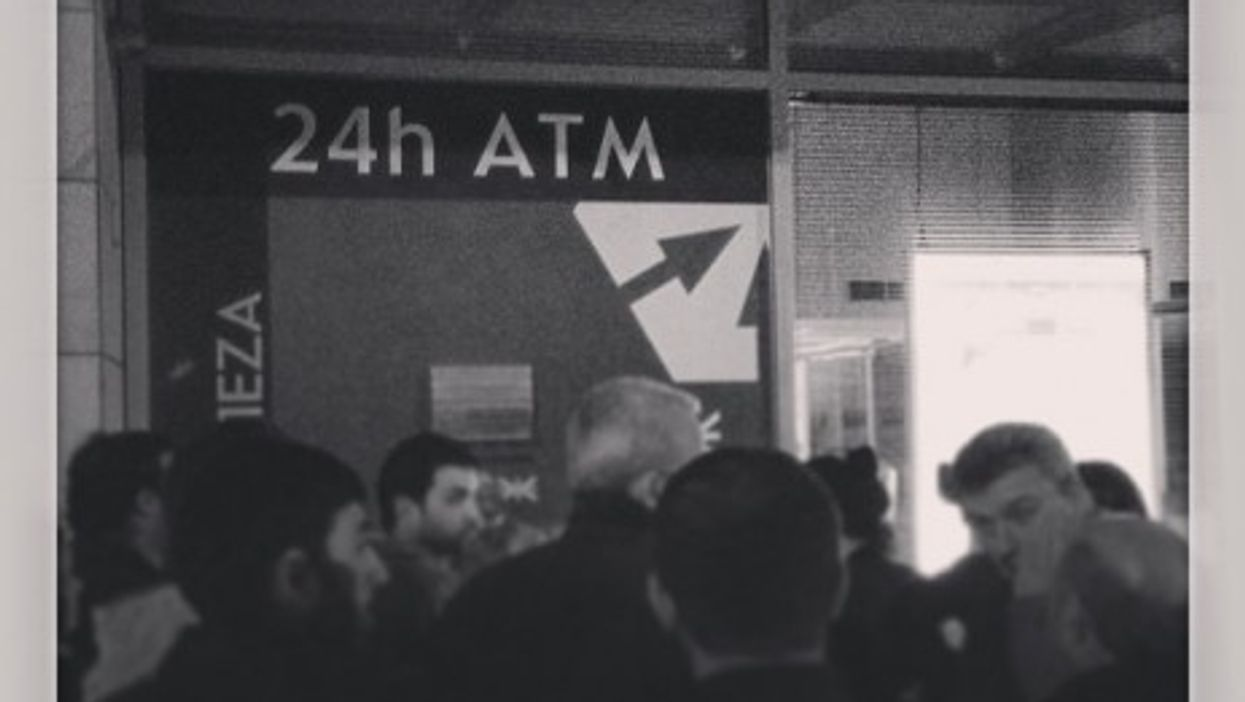 Queues at ATMs in Cyprus. Many are withdrawing the maximum 500 euros each day