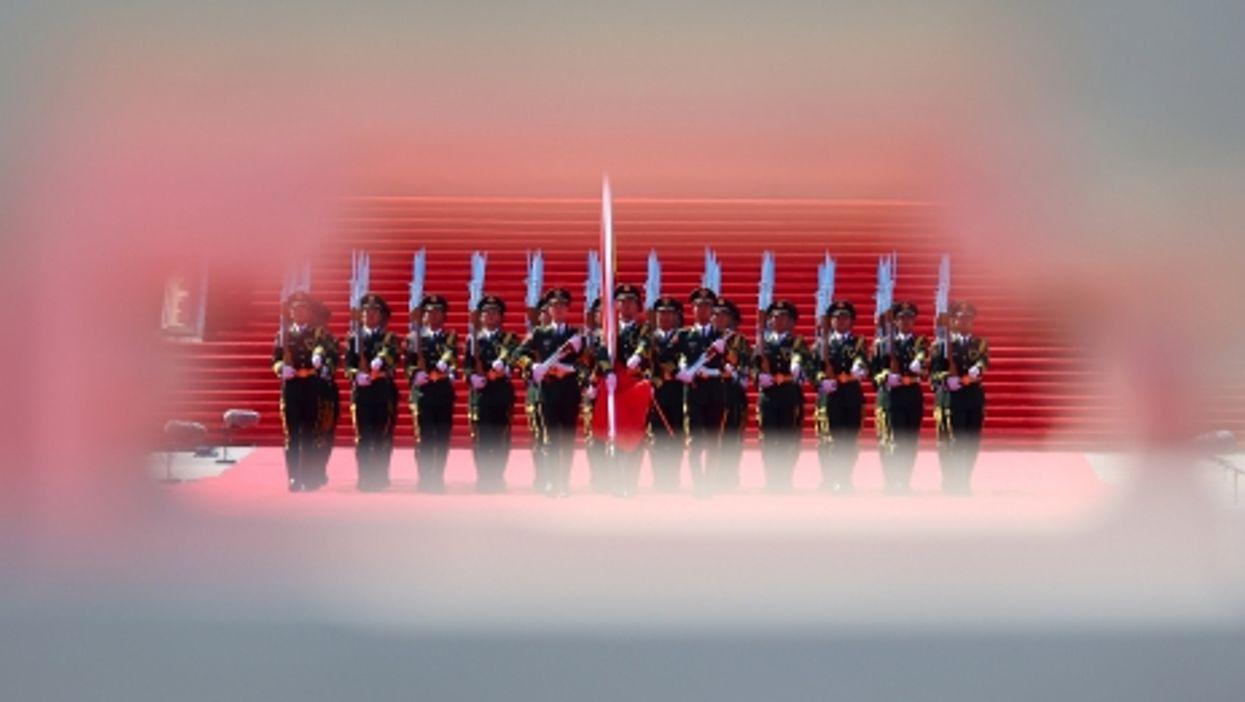 Raising the flag in Beijing