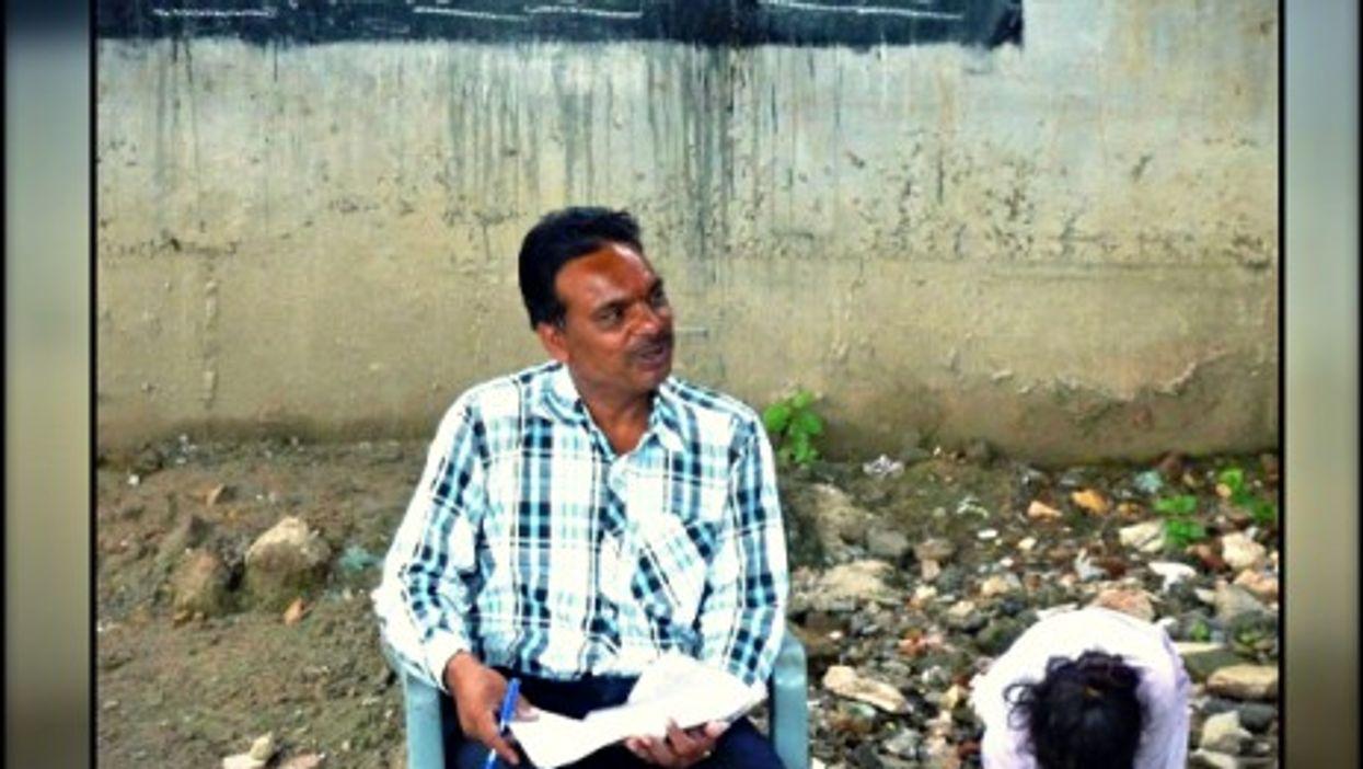 "Rajesh Kumar teaching at ""railway school"""
