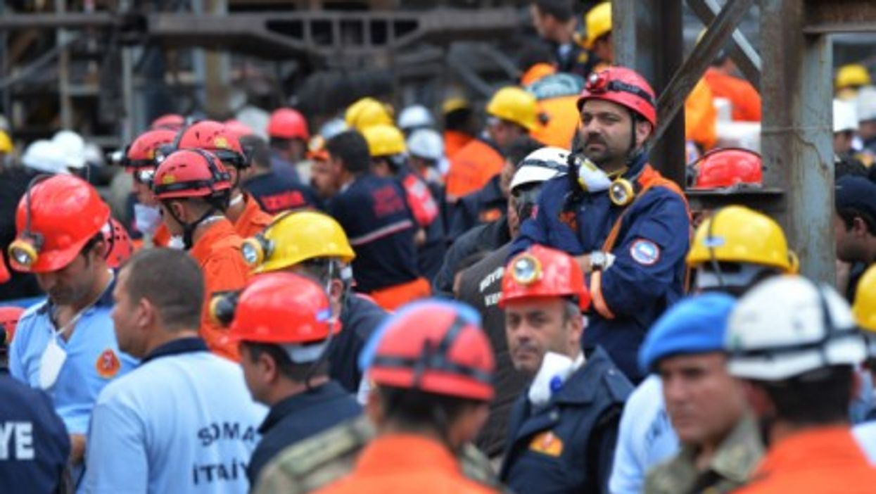 Recuers wait outside the entrance of the Soma mine on May 15.