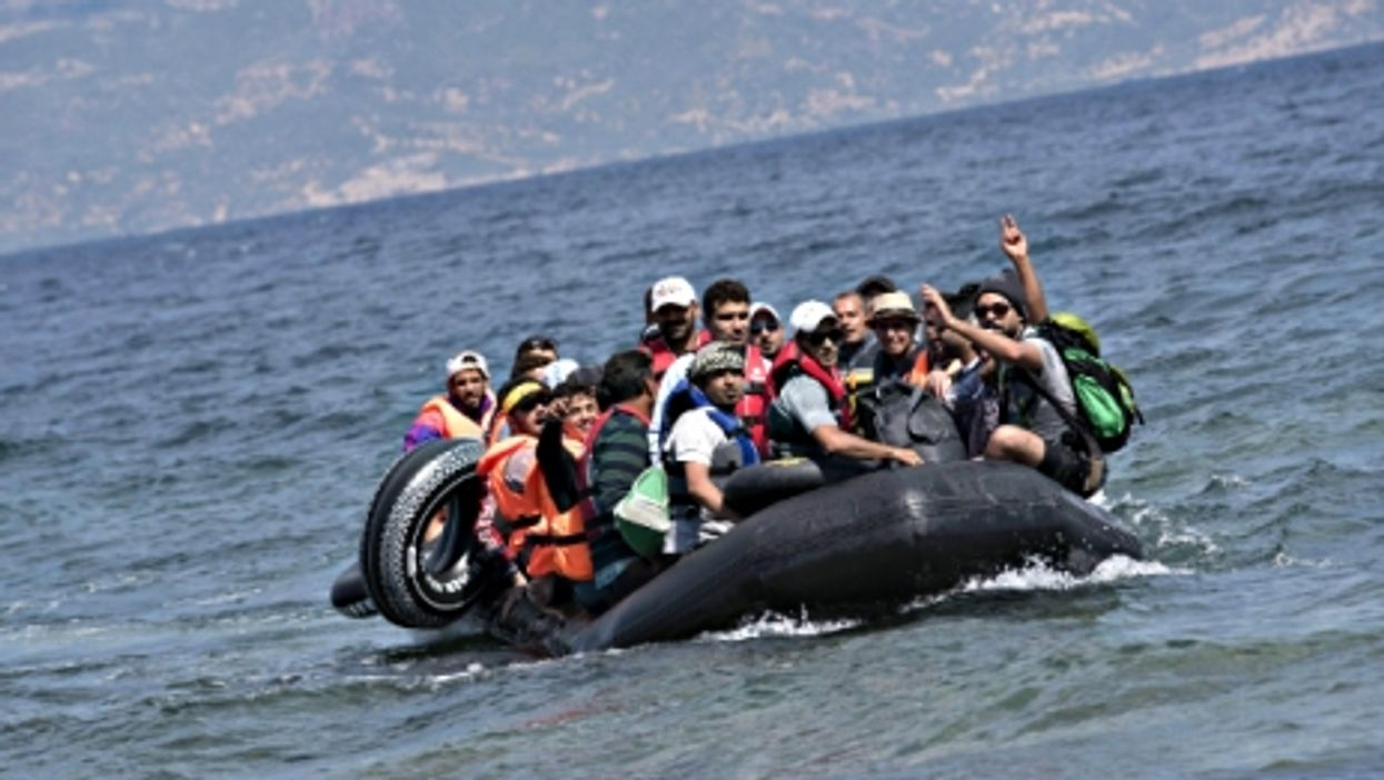 Refugees approaching the Greek shore after making the crossing from Turkey
