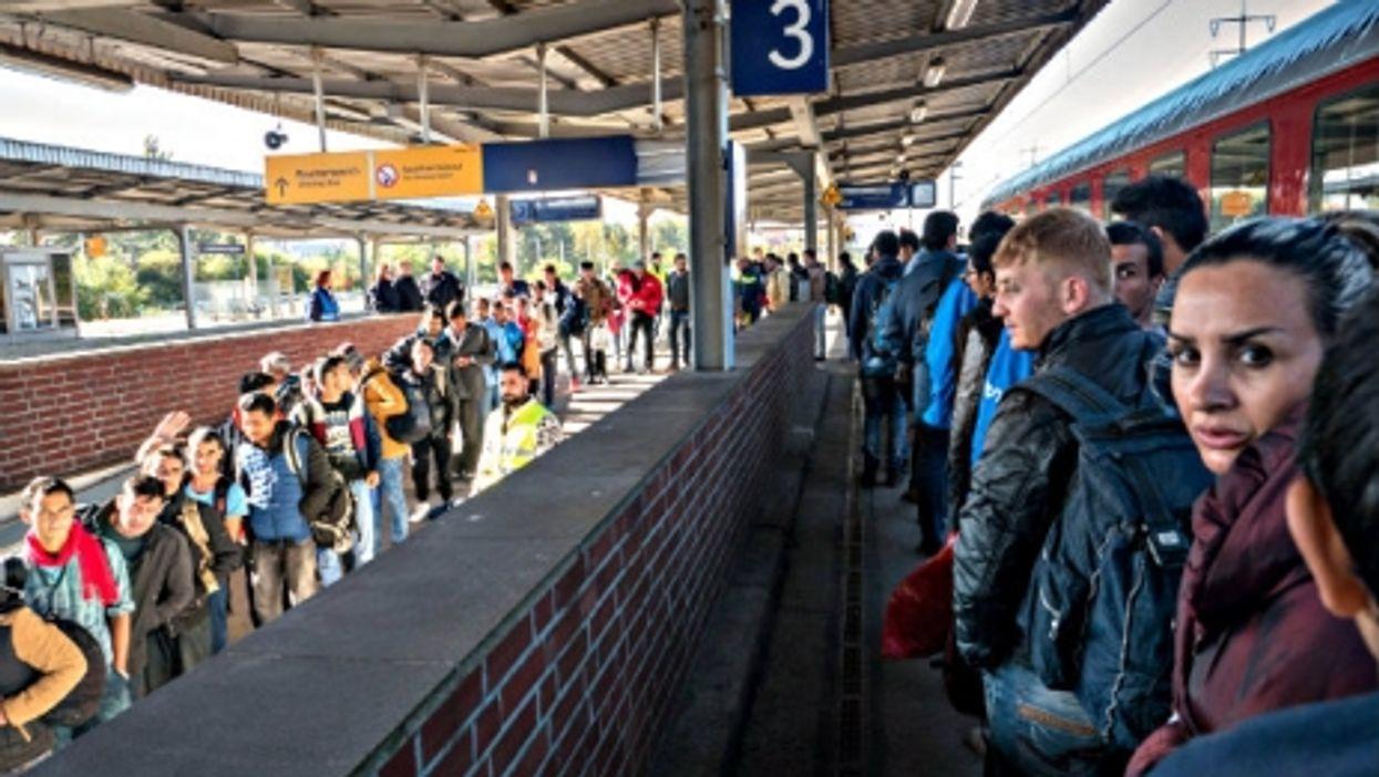 Refugees arriving in Berlin in October