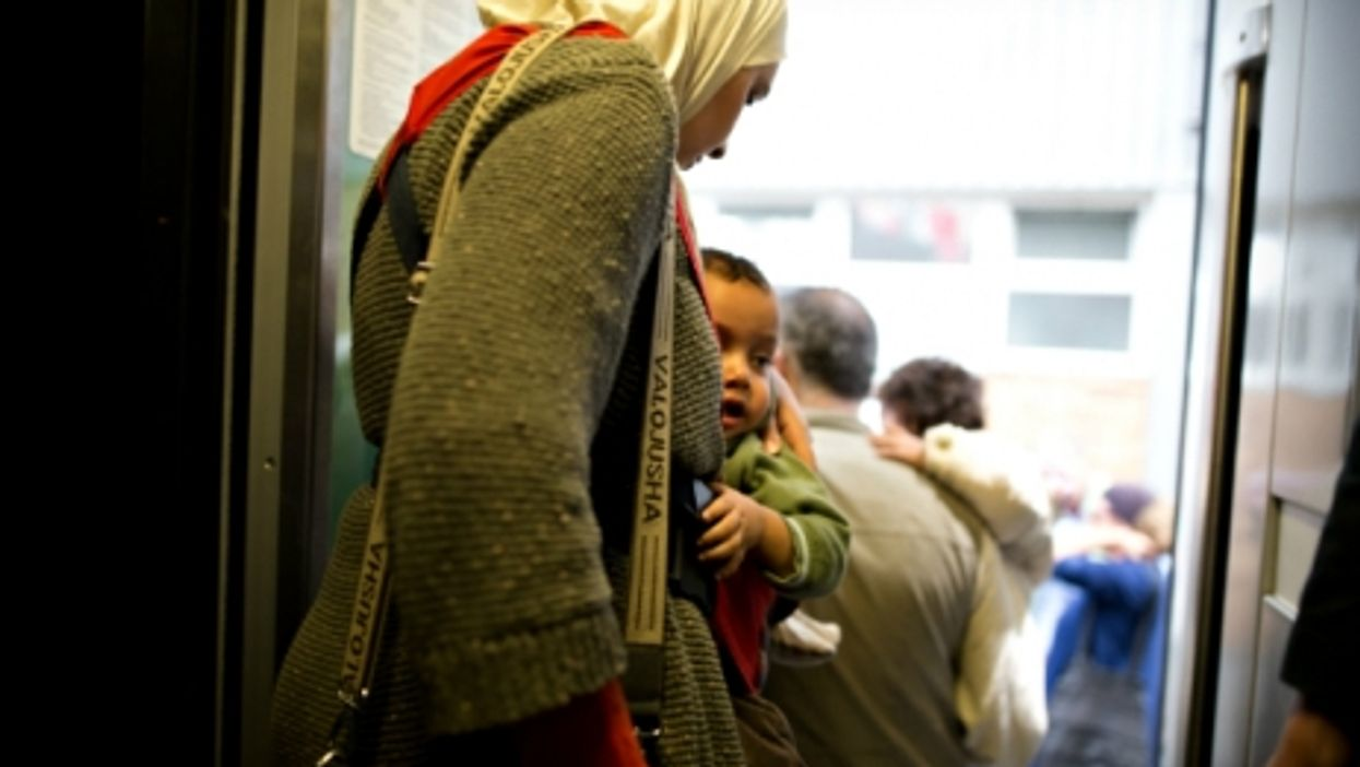 Refugees arriving in Munich's train station in September