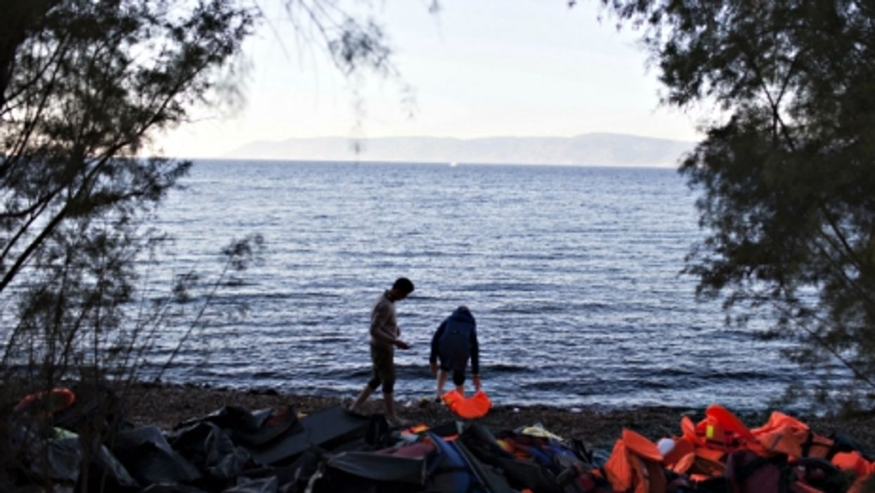 Refugees arriving on the Greek island of Lesbos after crossing from Turkey on a dinghy