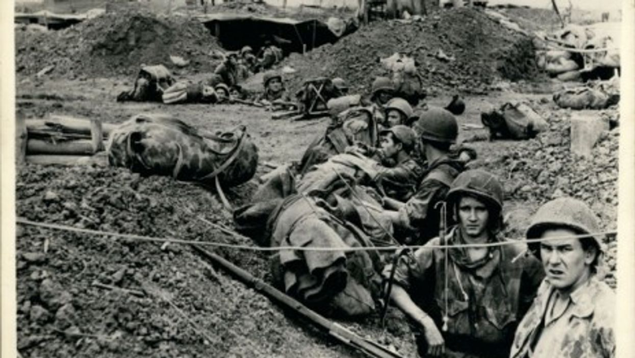 Reinforcements occupying positions in the dug-outs during the battle of Dien Bien Phu