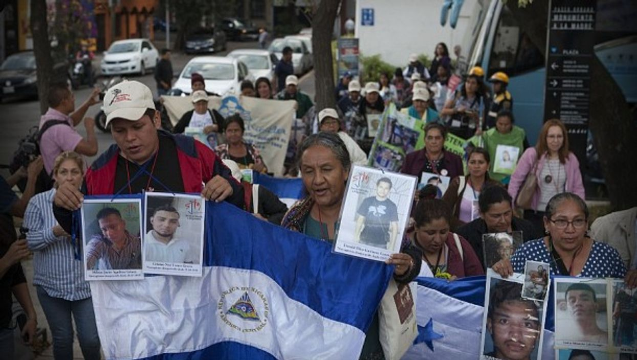 Relatives of people missing protest last year in Mexico City