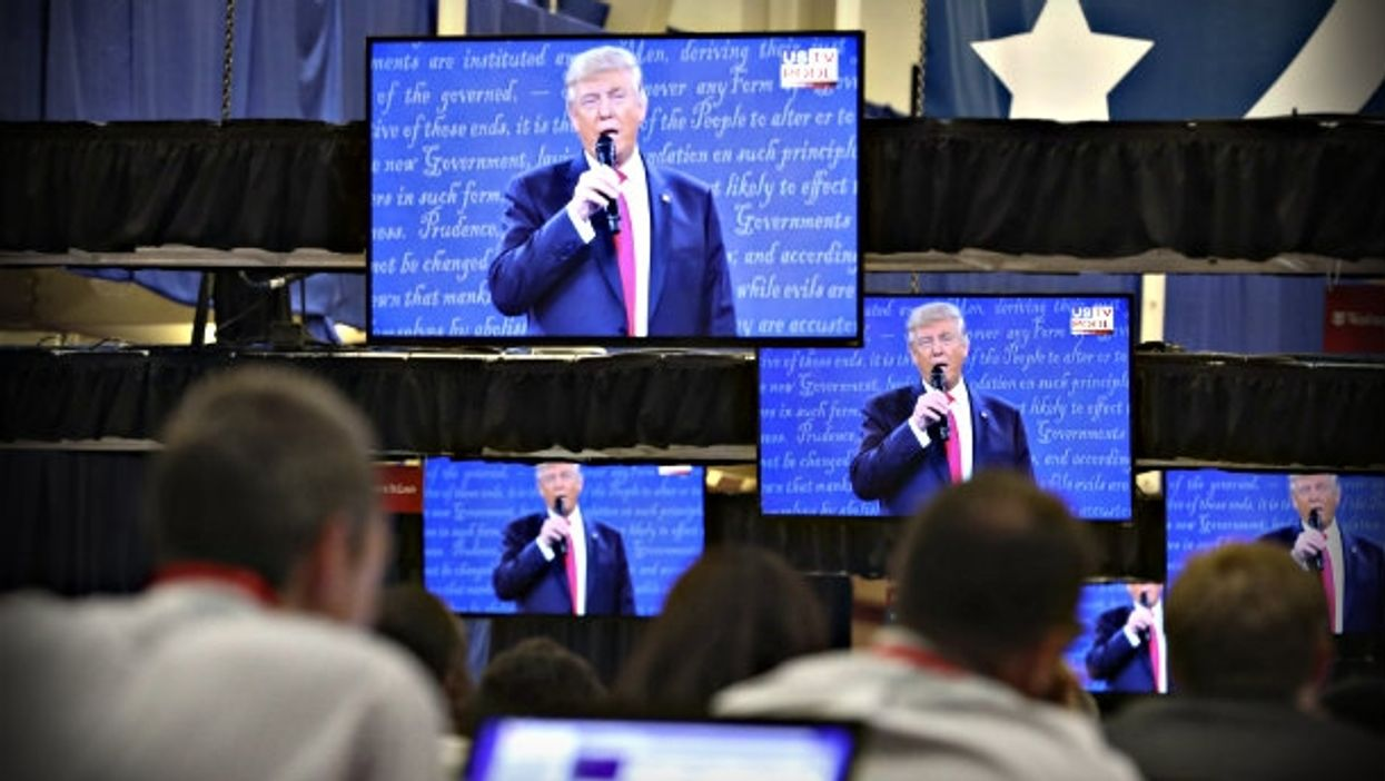 Reporters watch the second debate last month in St. Louis