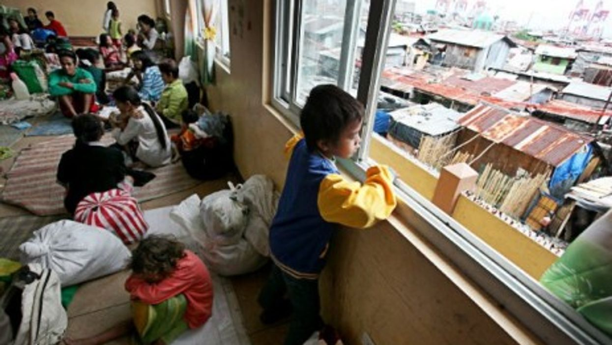 Residents in Manila take shelter from Typhoon Hagupit.