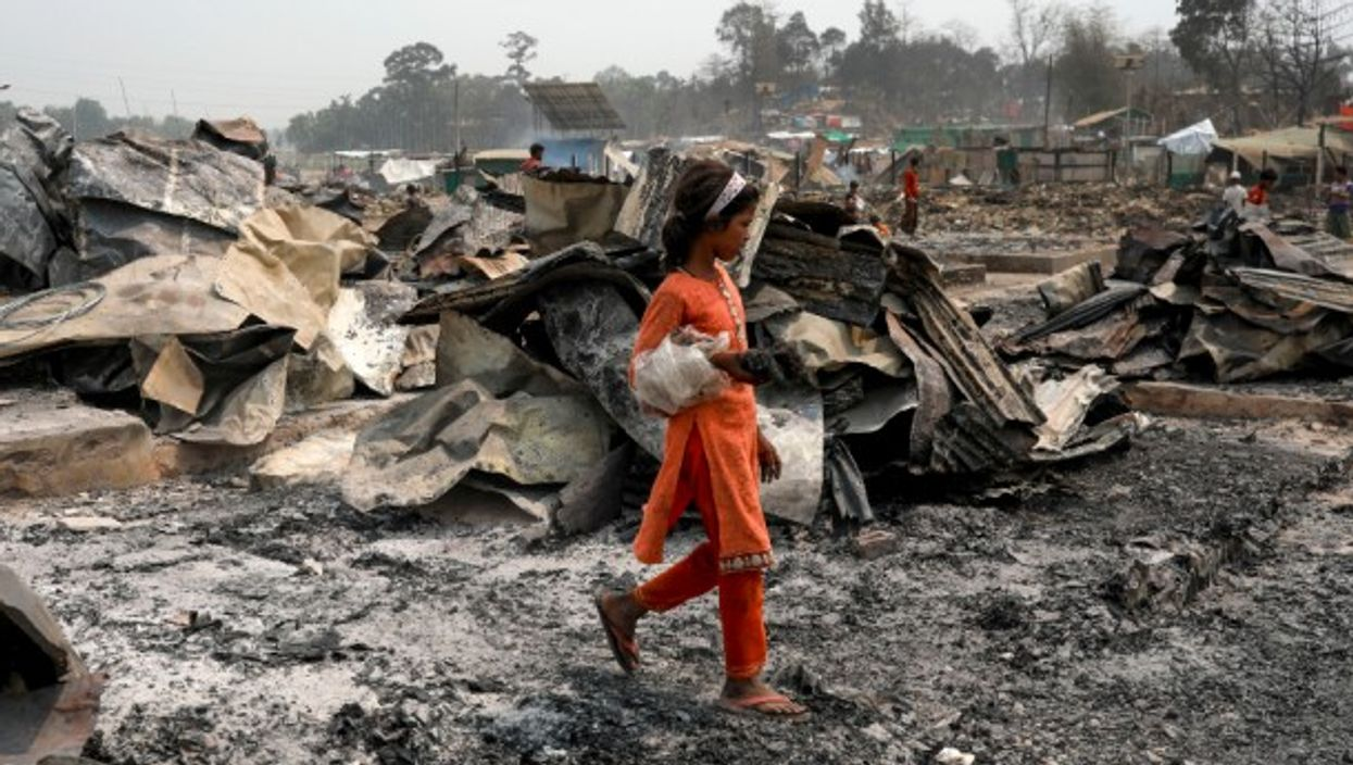 Rohingya refugees search for their belongings after a fire killed at least 15 people and injured more than 500 in a camp in Cox's Bazar, Bangladesh.