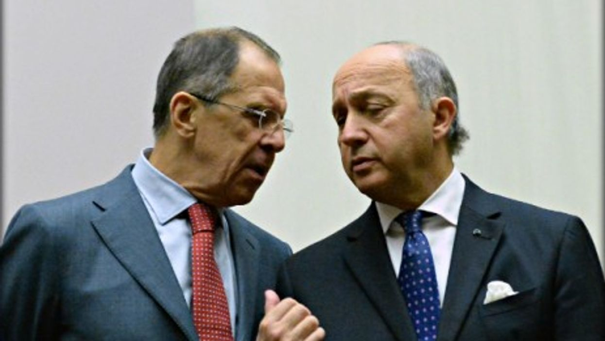 Russian Foreign Minister Sergei Lavrov and French Foreign Minister Laurent Fabius on Nov. 24