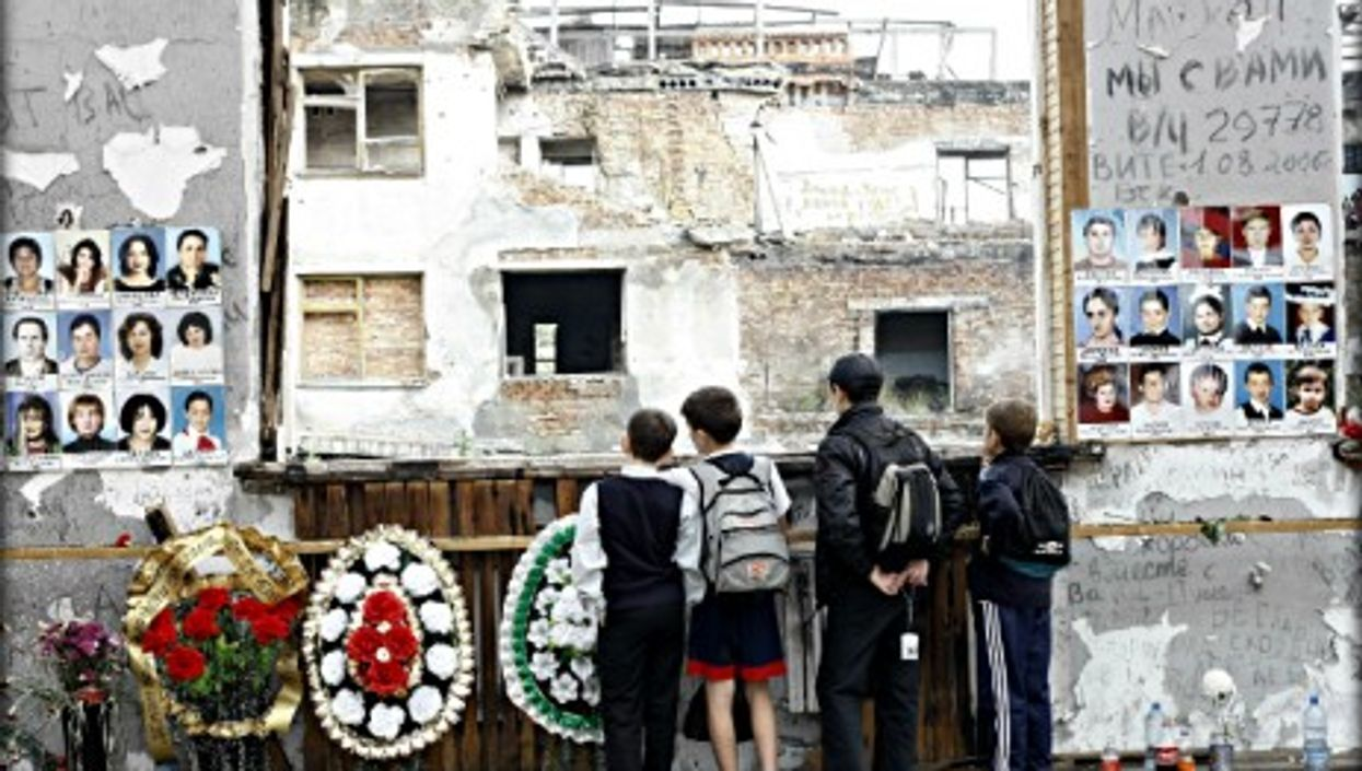 Russian schoolboys standing where the Beslan hostage crisis took placeon Sept.1, 2004