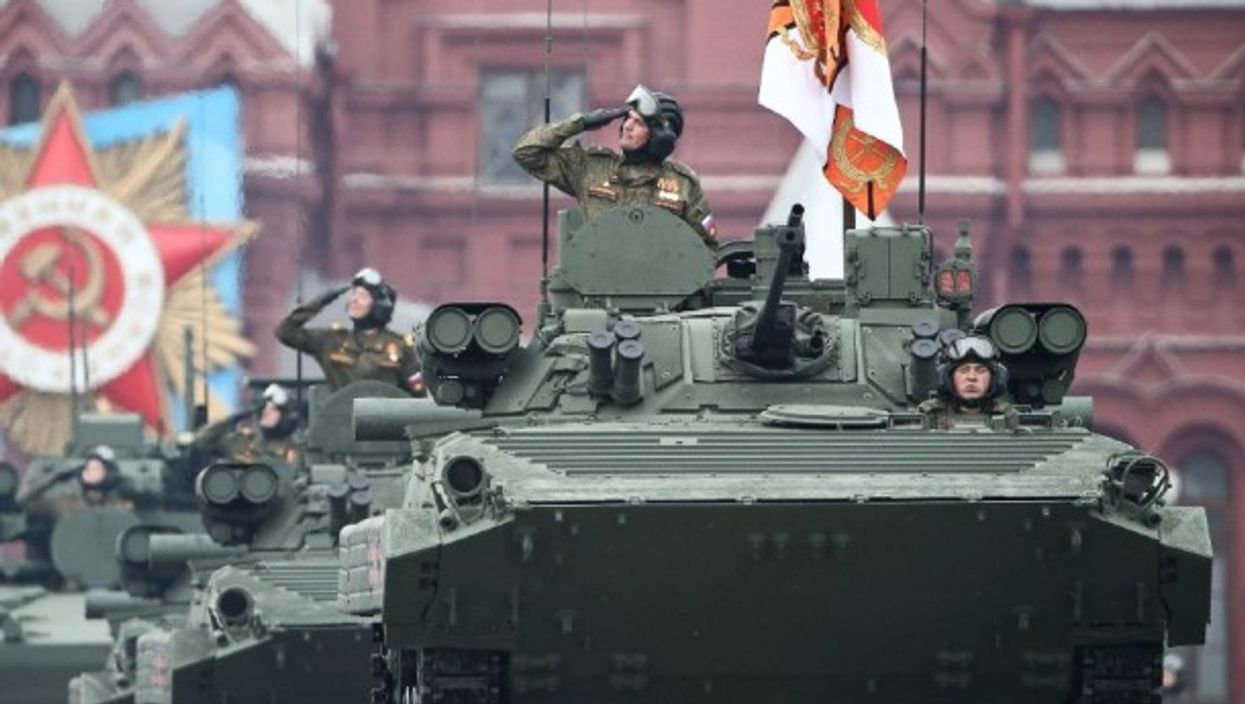 Russian tanks roll down Moscow's Red Square during a Victory Day military parade on May 9 which marked the 76th anniversary of the victory over Nazi Germany during World War II