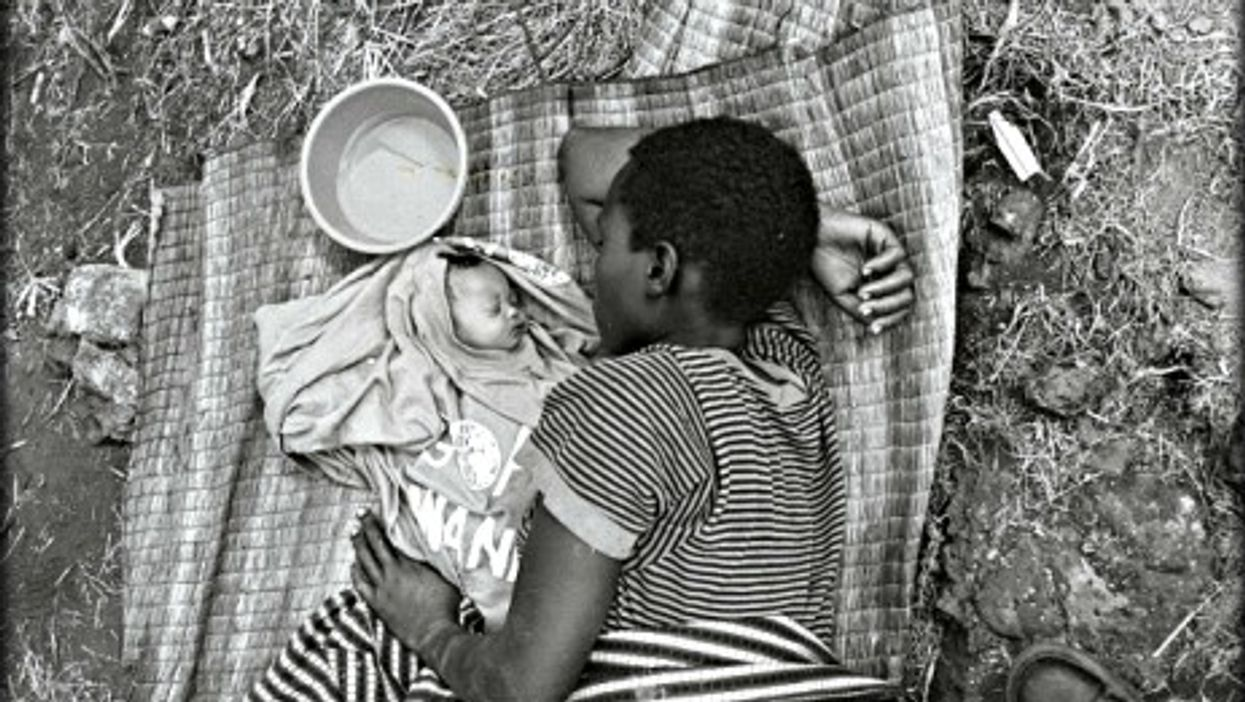 Rwandan mother and baby sleeping in a refugee camp