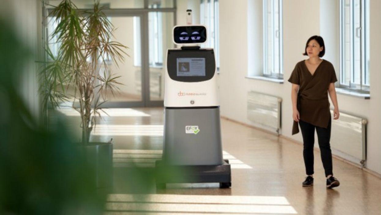 Sara Pereira passes the security robot ''Roboguard'' at a press conference for a security fair, on Sept. 20.