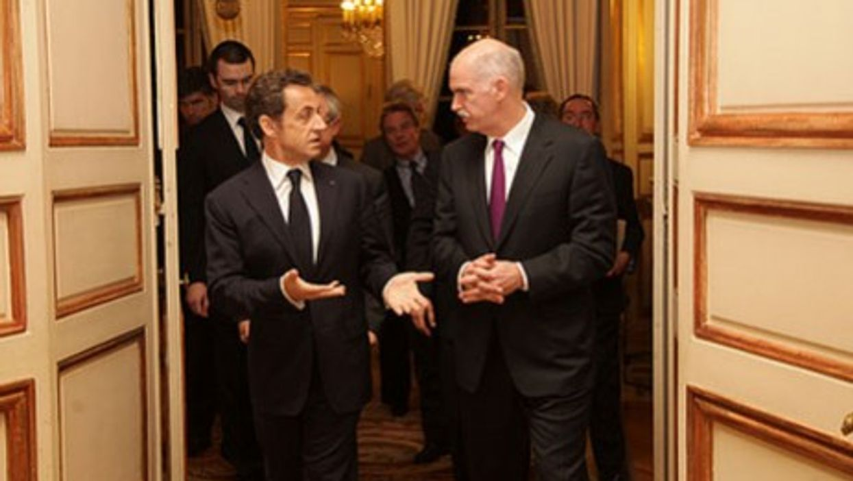 Sarkozy, shown with the Greek Prime Minister Papandreou, likes to mingle with French intellectuals.