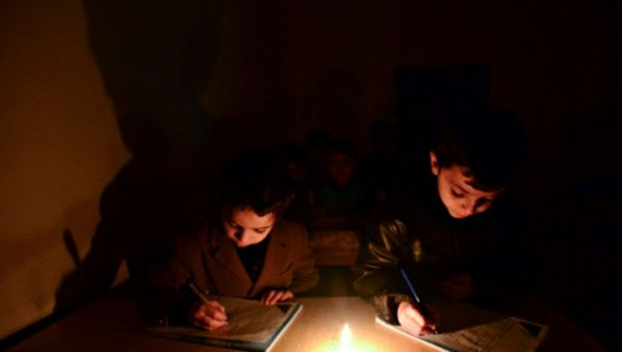 Schoolchildren studying without electricity in Aleppo, Syria