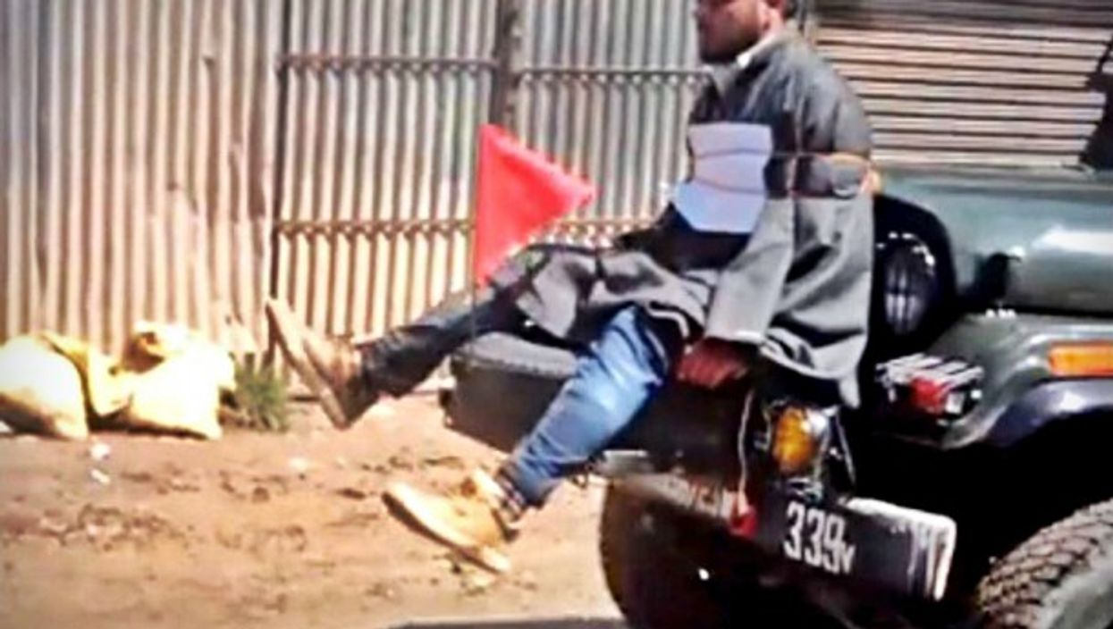 Screenshot of video of Farooq Ahmad Dar being used as human shield