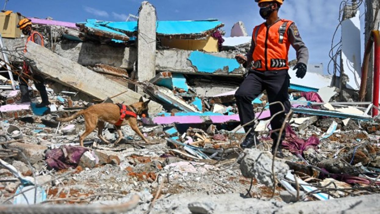 Searching for victims in the rubble in Mamuju after the Indonesian island of Sulawesi was hit by a 6.2 magnitude earthquake on Jan. 15, killing at least 81.