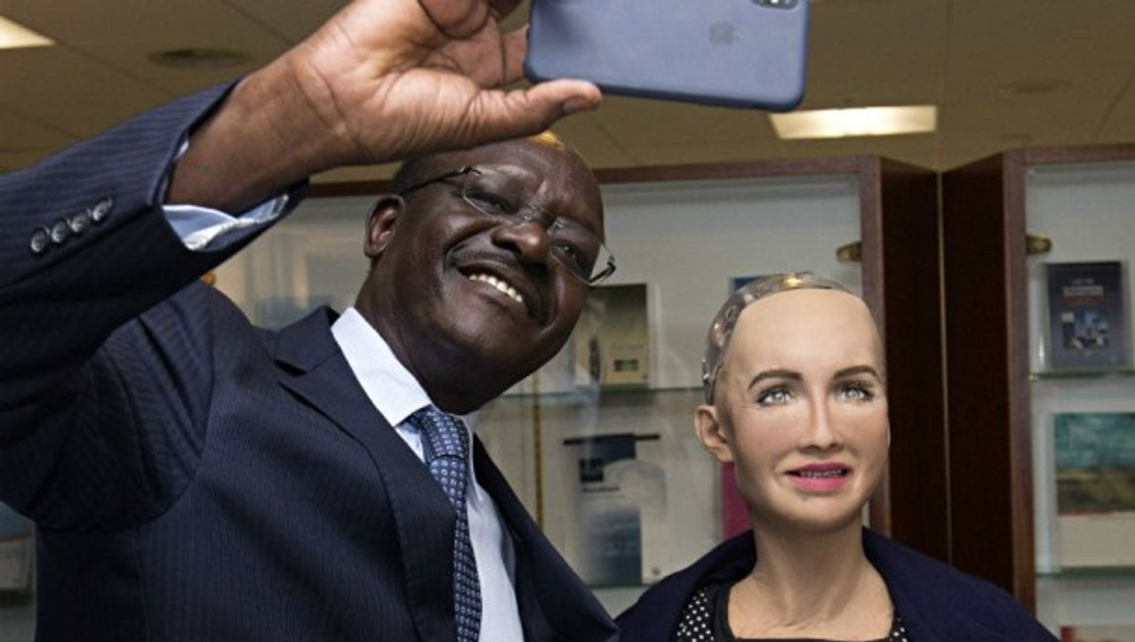 Secretary-General of the United Nations Conference on Trade and Development cozies up to AI Robot Sophia