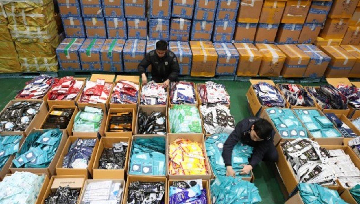 Seizing smuggled masks in Incheon, South Korea, on Feb. 13