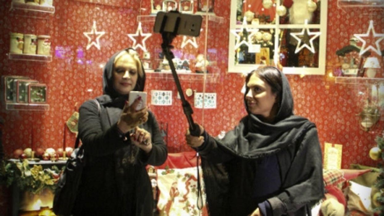 Selfie sticks and holiday cheer in Tehran in December