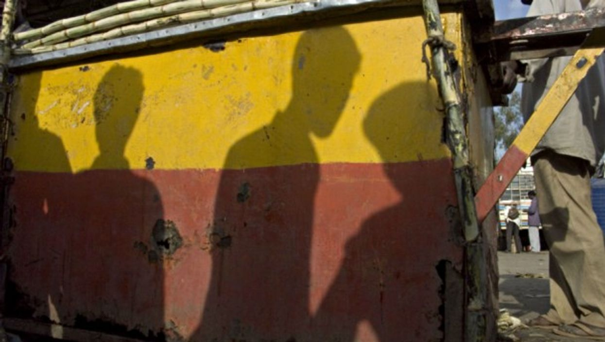 Shadows of workers in Bangalore, India