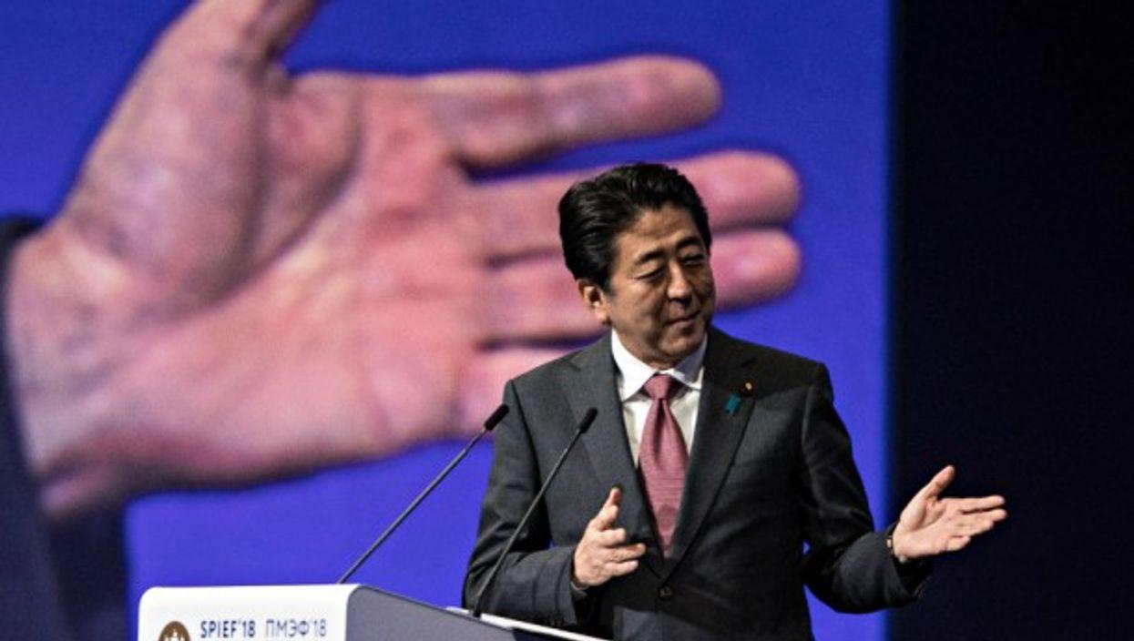 Shinzo Abe lending a hand