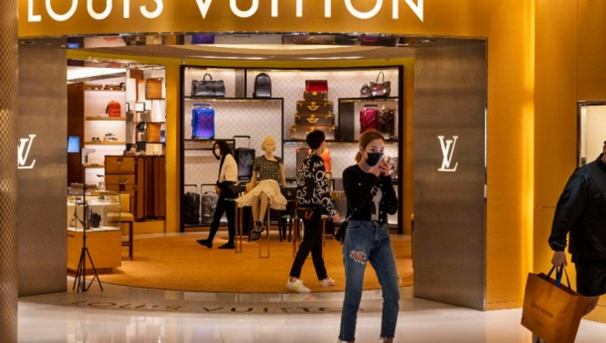 Shoppers at a French luxury fashion brand Louis Vuitton store
