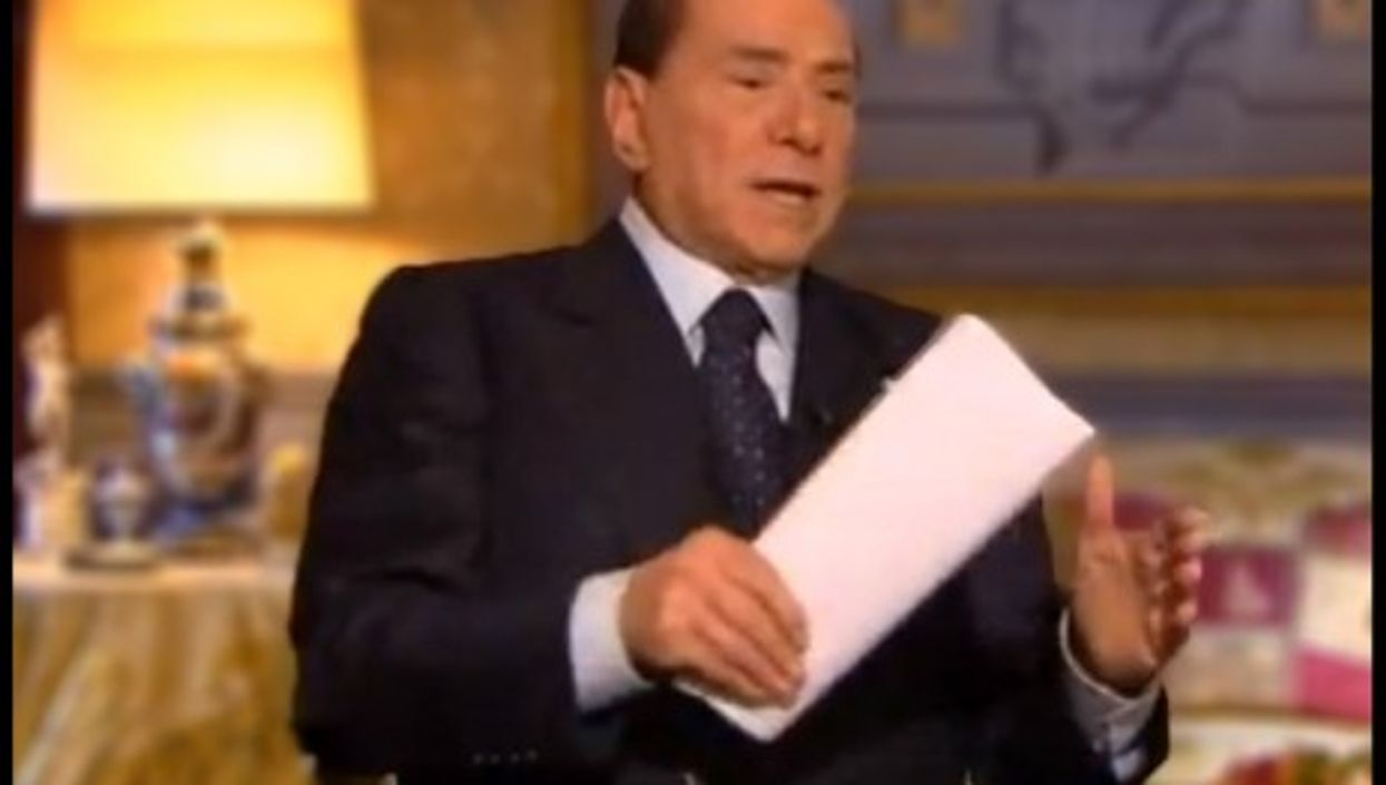 Silvio Berlusconi carries his list of promises with him on TV