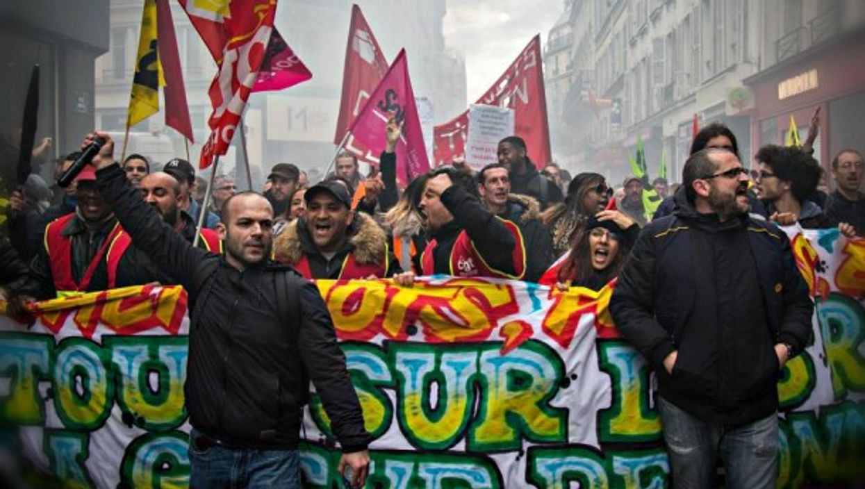 SNCF employees protest against Macron's reform plans.