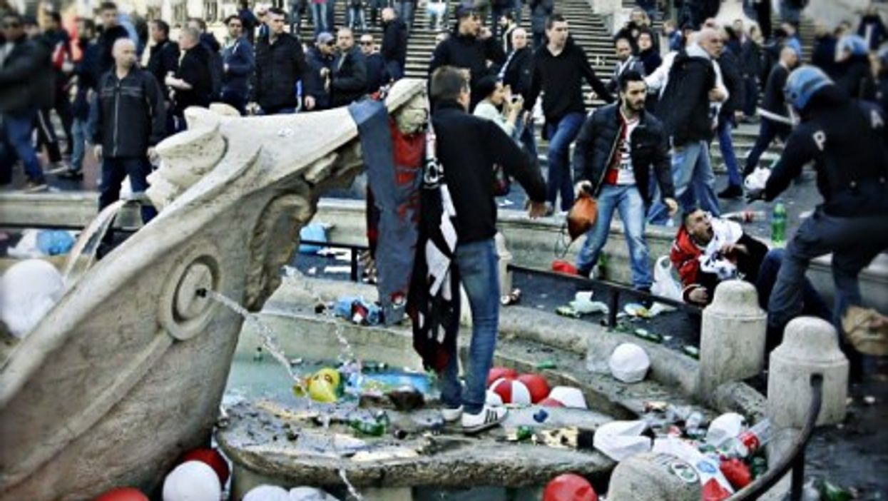 Soccer fans clash with police forces next to Rome's Fontana della Barcaccia