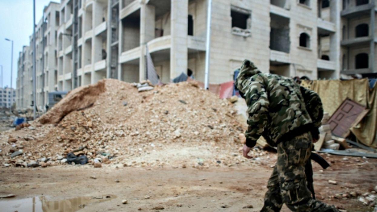 Soldier running in Bustan al-Qasr, Aleppo