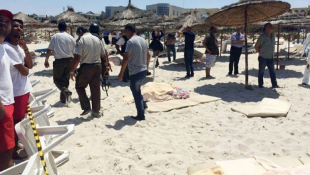 Soldiers and onlookers at the site of the attack in Sousse