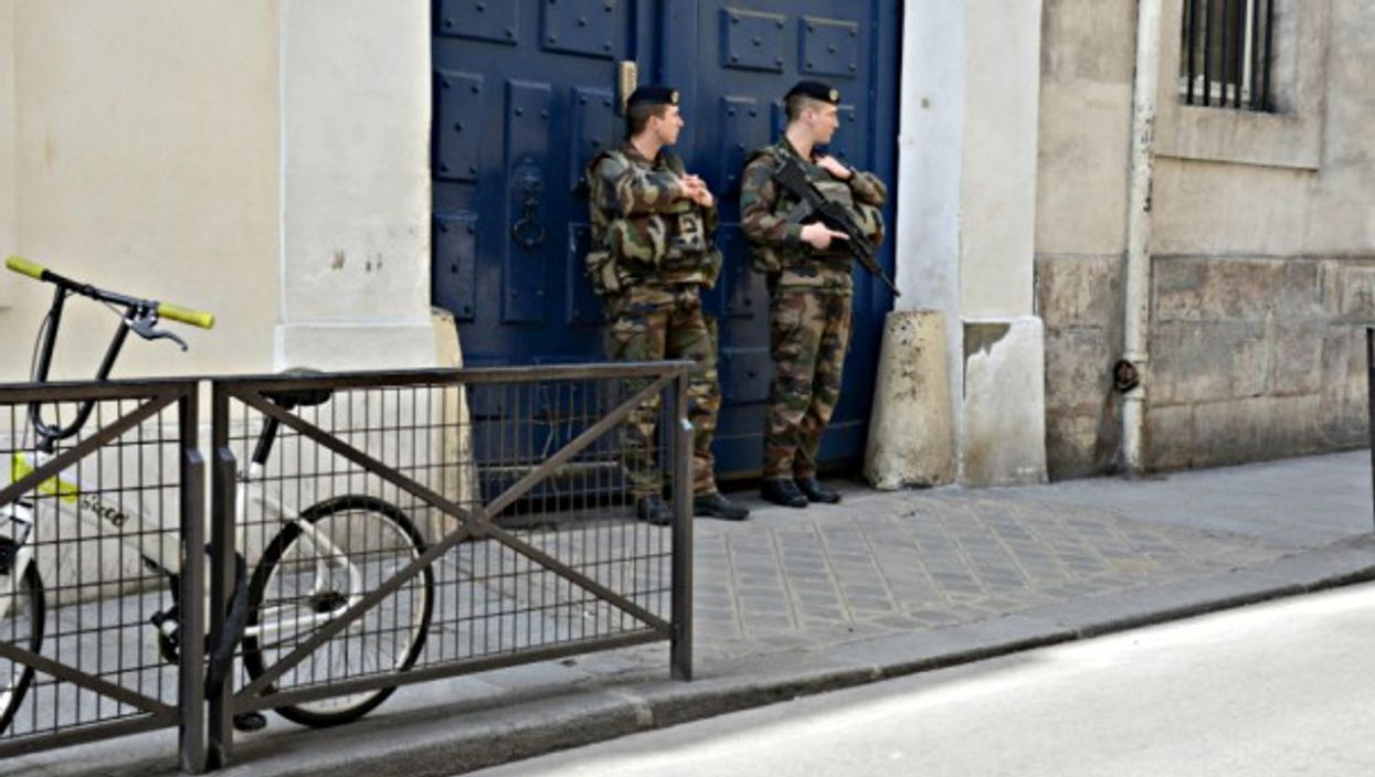 Soldiers guard the entrance of a synagogue in Paris