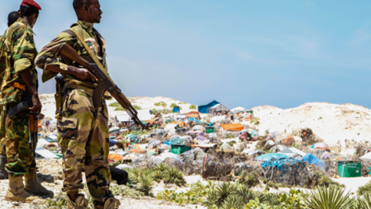 Soldiers watch over a Mogadishu slum