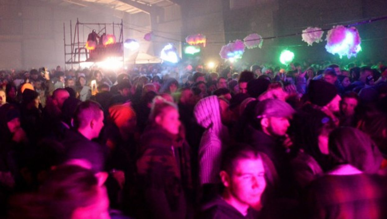 Some2,500 people hadcrowded into a hangar in the northwestern town of Lieuronfor a'free rave'