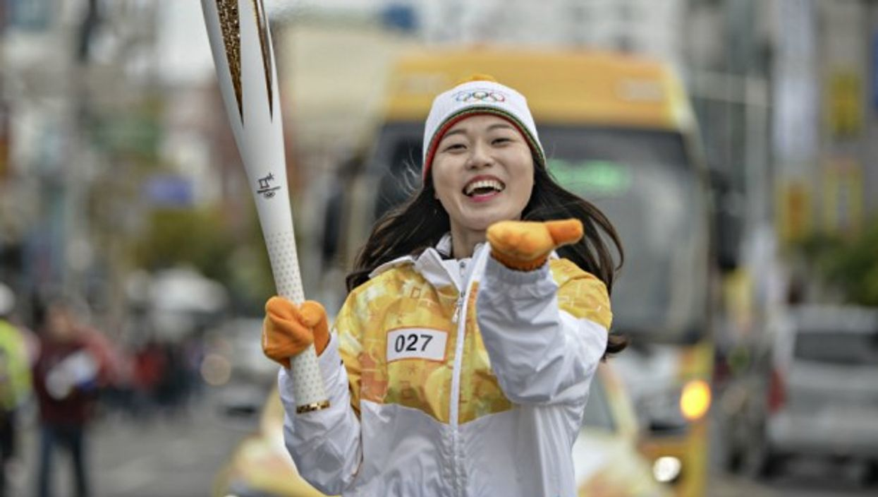South Korean runner carrying the Olympic torch in Tongyeong