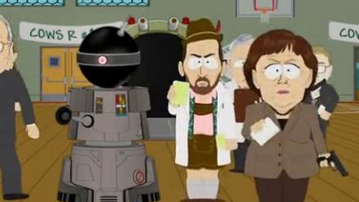 South Park's version of Angela Merkel on stage with the 'Funnybot' (Comedy Central)