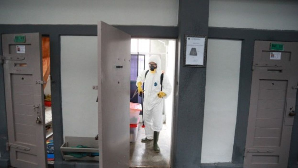 Spraying disinfectant in an Indonesian jail