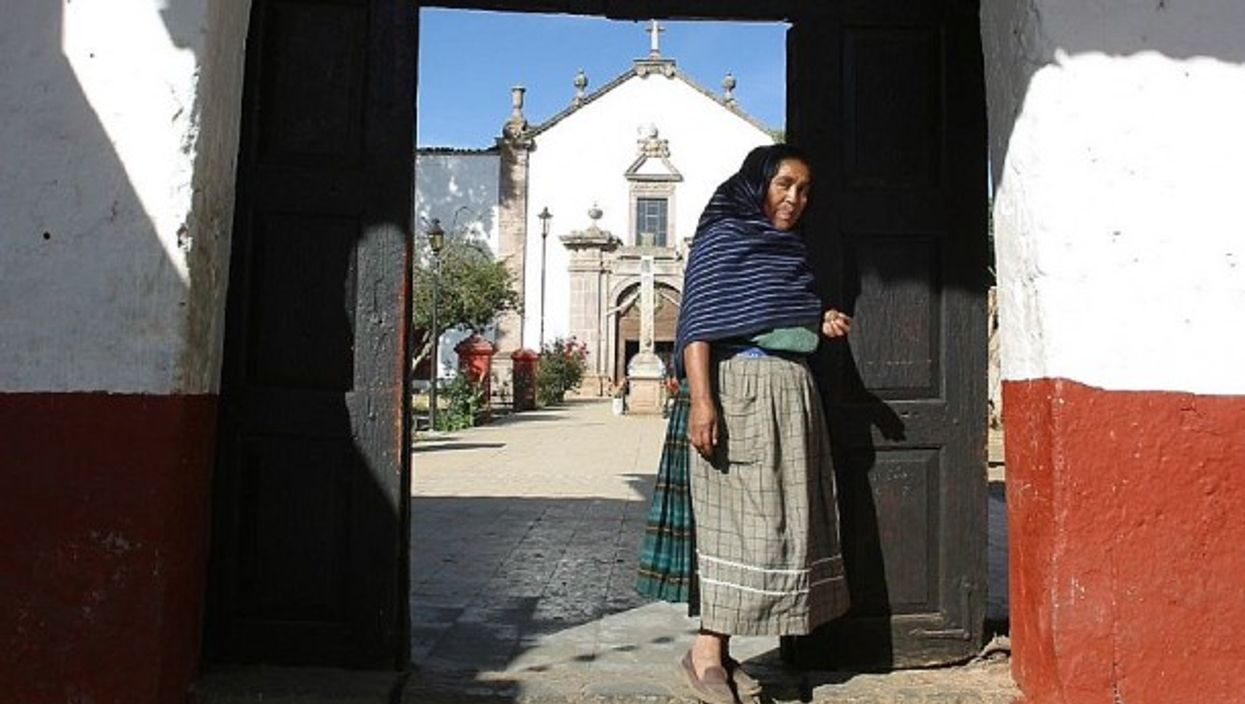 Standing in the doorway, in Michoacán, Mexico