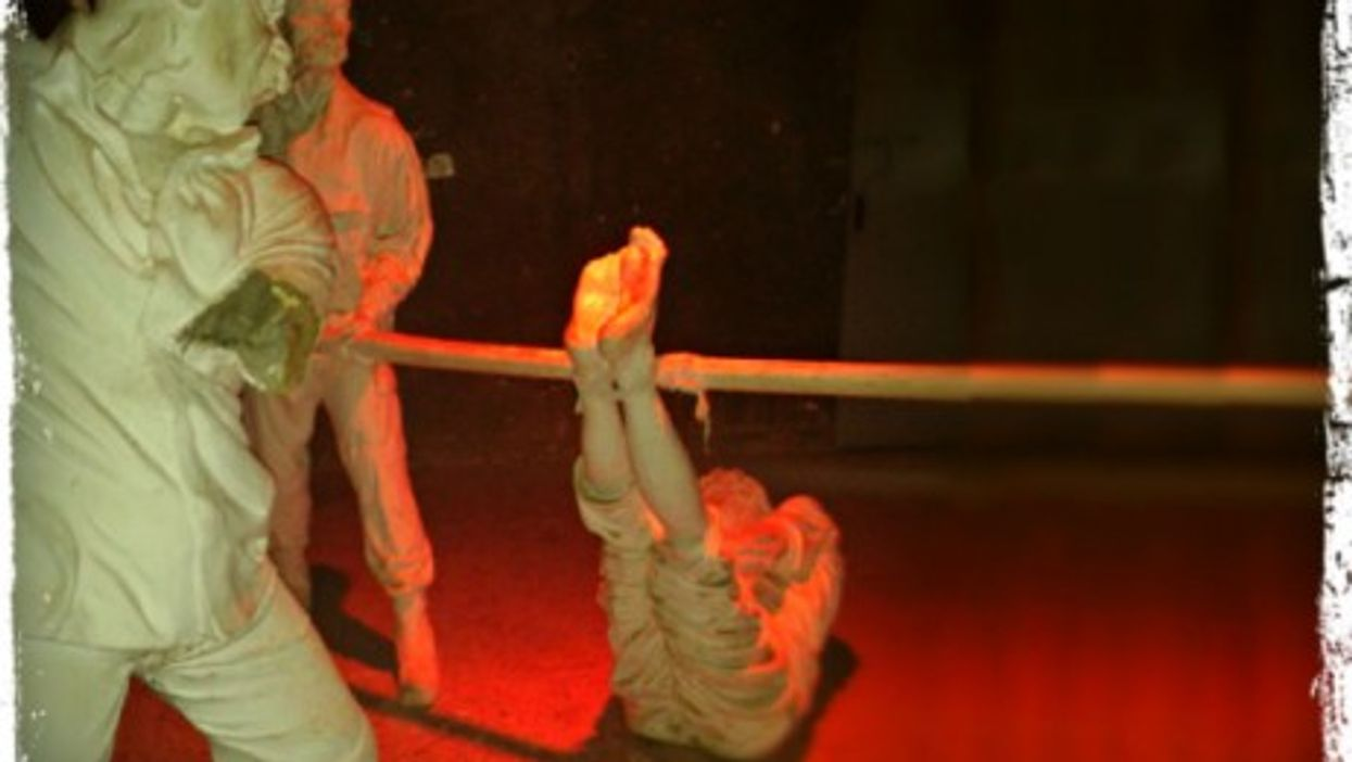 Statues in a Syrian museum showing torture methods of detainees
