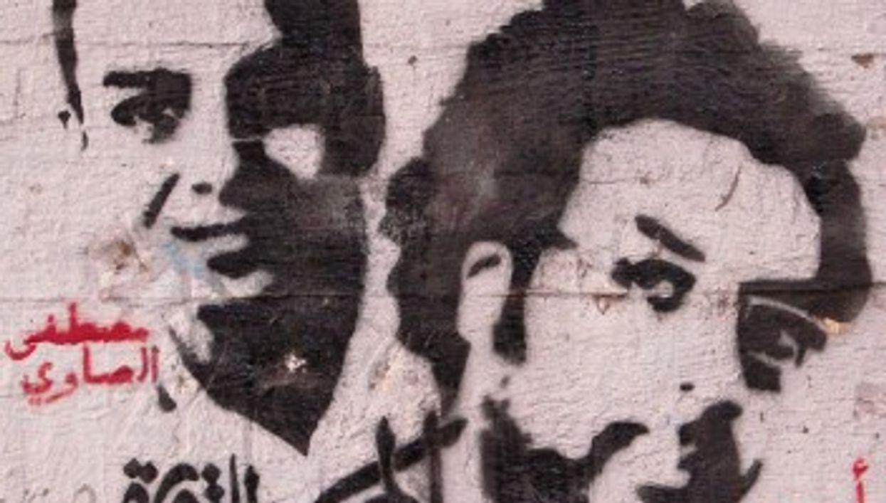 Stencil art of revolutionary martyrs (left to right) Mustafa al-Sawy and artist Ahmad Basiony