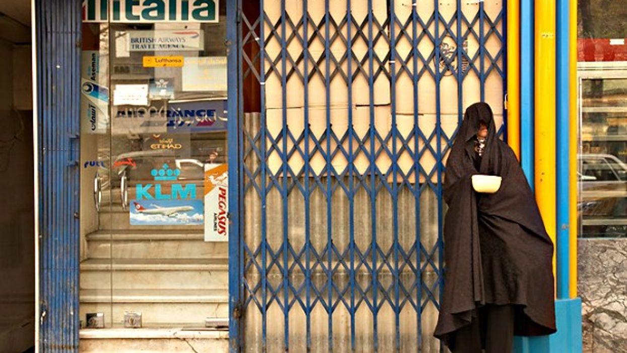 Street beggar wearing a hijab in Tehran
