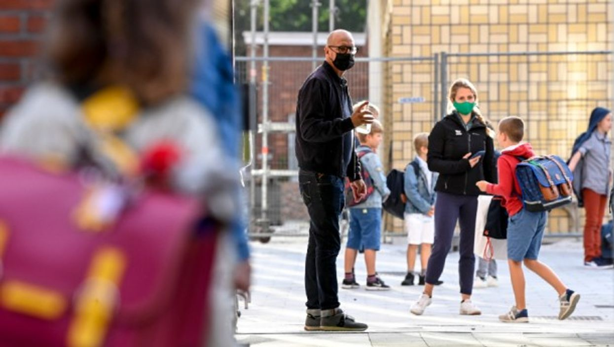 Students arriving for their first day of school in Belgium.