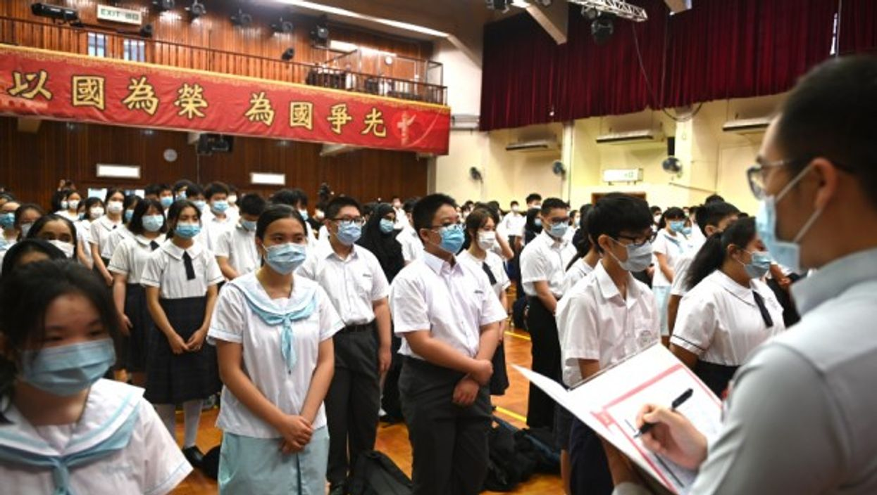 """Students in Hong Kong take part in a ceremony to celebrate the first """"National Security Education Day,"""" organized by the government to promote the controversial law imposed by China last year."""