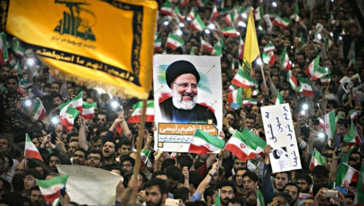 Supporters of Iran's presidential challenger Ebrahim Reisi