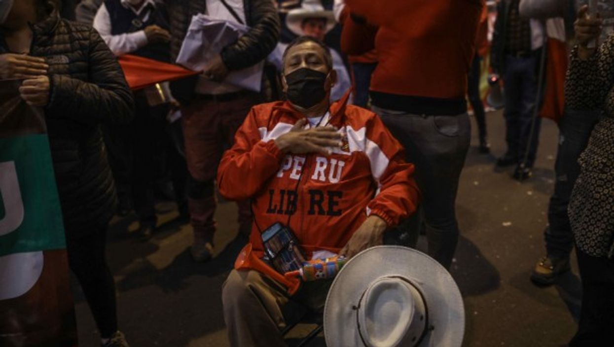 Supporters of Pedro Castillo celebrate in Lima, Peru, after the leftist candidate claimed victory in the country's presidential election with a narrow lead of 44,058 votes ahead of right-wing rival Keiko Fujimori. However the result of the ballot has not